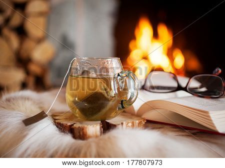 Cup of tea by the fireplace