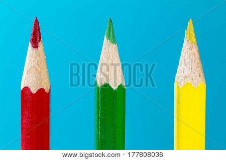 three colored pencils red yellow and green