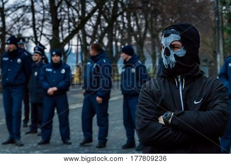 Uzhhorod western Ukraine - March 18 2017: A masked activist partakes in the Black March of the Glory of the Heroes of Carpathian Ukraine in Uzhhorod.