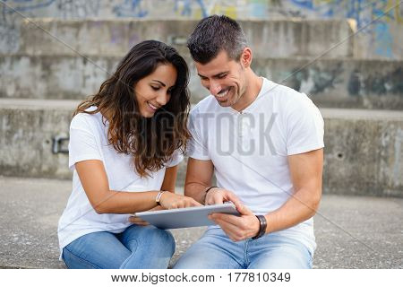 Young Couple Using Digital Tablet Together