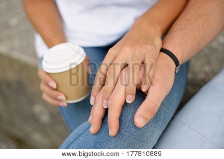 Close Up Of Clasped Lovers Hands With Affection