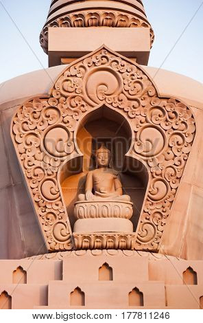 Buddha's image on the Wisdom Stupa or a stupa of Turn of the Wheel of the teaching. The stupa is constructed Dilgo Khyentse in the city of Sarnath near the Cervine Park where Buddha gave the first teaching.