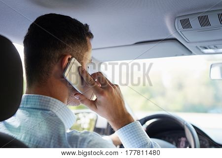 Young Businessman Sitting In Car And Call