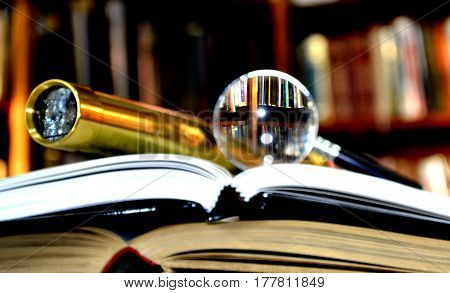 cose up Map telescope magnifying glass on books