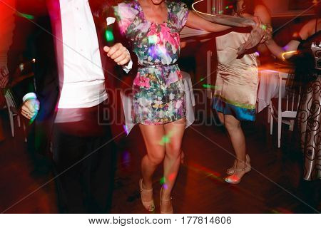 Lady With Long Tanned Legs Dances In A Restaurant Hall