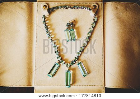 Necklace And Earrings With Square Crystals Put In A Leather Cover