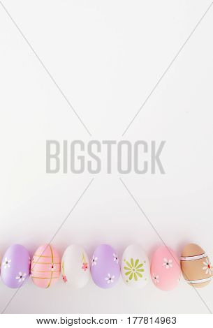 Colorful Easter Eggs On White Background With Space For Message