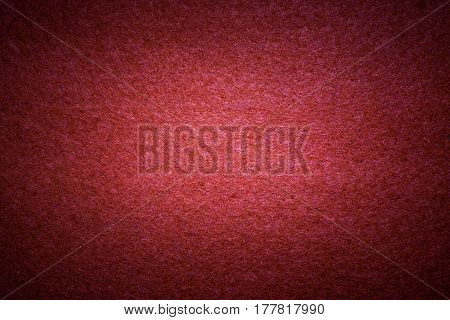 Flat surface with red felt texture with center soft light.