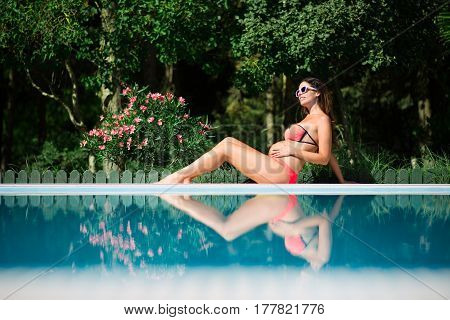 Pregnant Woman Relaxing On Summer Vacation