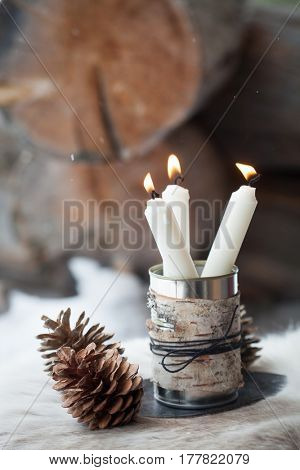 Candles outdoors in tin can
