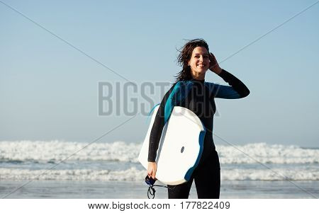 Woman Leaving The With Bodyboard After Surfing