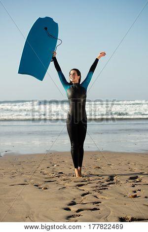 Surfer Woman Having Fun With Bodyboard At The Beach
