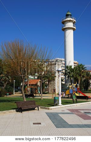 TORRE DEL MAR, SPAIN - OCTOBER 27, 2008 - View of the lighthouse and childrens playground along the promenade Torre del Mar Malaga Province Andalusia Spain Western Europe, October 27, 2008.
