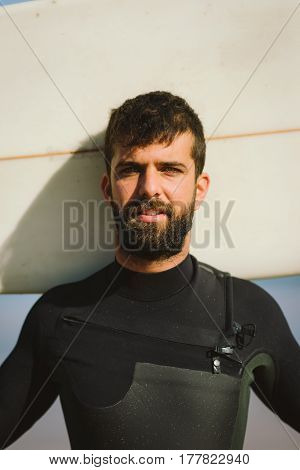 Bearded Male Surfer Portrait Holding His Surfboad