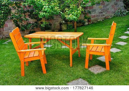 a deska and two chairs in the garden
