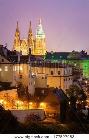 Night city view in Prague with Hradcany Castle.