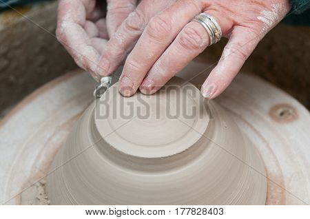 Pottery Making With Womans Hands Working At The Pottery Wheel