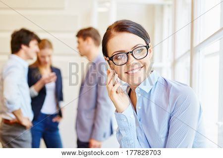 Young businesswoman on the phone during a meeting