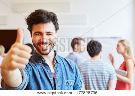 Man as student in start-up holding thumbs up