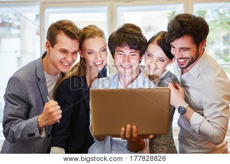 Business people looking at website in laptop computer