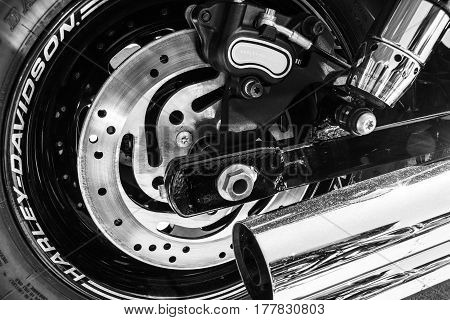Indianapolis - Circa March 2017: Rear Tire Brake Rotor and Exhaust Pipe of a Harley Davidson. Harley Davidson Motorcycles are Known for Their Loyal Following II