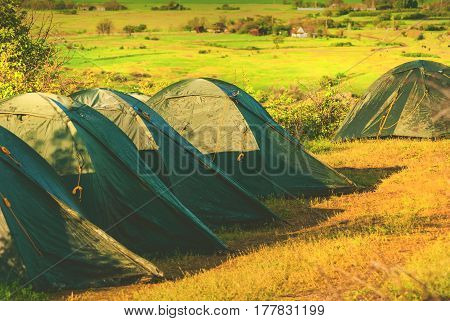 Camping tents in a valley of Ukrainian National park. Selective focus.