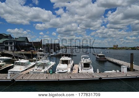 A summer day with boats docked in Boston Harbor.