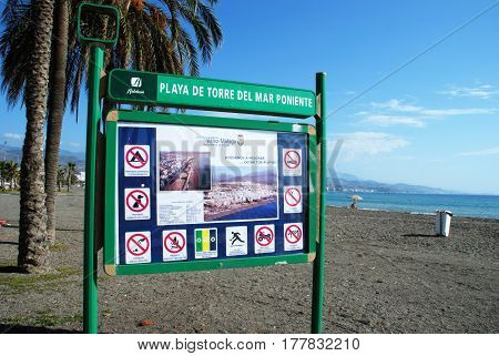 TORRE DEL MAR, SPAIN - OCTOBER 27, 2008 - Beach sign with photographs on the beach Torre del Mar Malaga Province Andalusia Spain Western Europe, October 27, 2008.