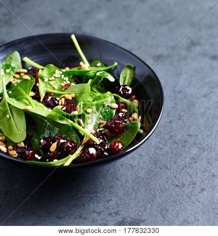 Spinach salad with pomegranate seeds and dried cranberries