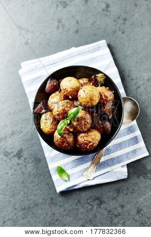 Oven-roasted potatoes and red onions