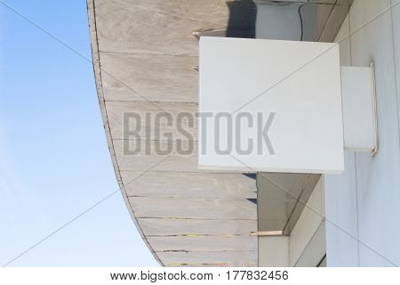 horizontal side view of empty white square signage on the exterior of a building