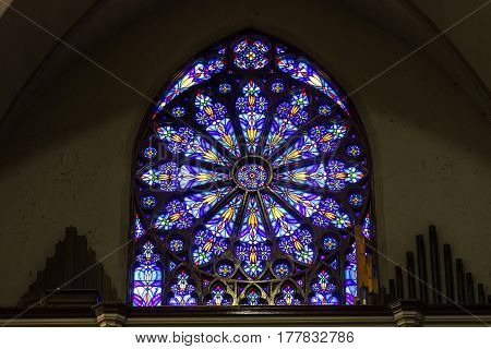 Indianapolis - Circa March 2017: St. Mary Catholic Church Stained Glass Window resembling the South Rose Window I