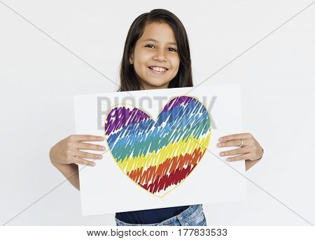 Woman holding placard with LGBT heart icon