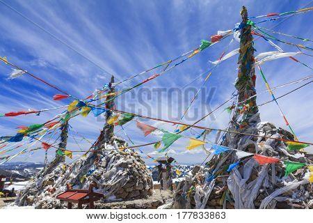 Prayer flags and stupa at the top of Blue Moon Valley (Shika Snow Mountain) Shangri-La Yunnan China