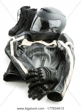 Motorcycle helmet, gloves, jacket and boots isolated on white background.