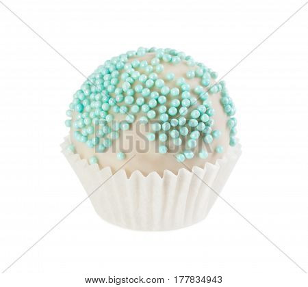 Cake Ball In White Glaze With Blue Sprinkles In Paper Form