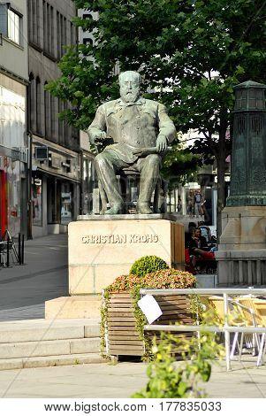 Oslo Norway - July 22 2014: Statue of Christian Krohg on Karl Johans gate. Christian Krohg was a Norwegian naturalist painter illustrator author and journalist.