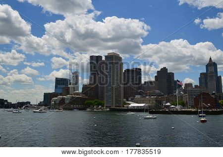 Blue skies and fluffy white clouds over the City of Boston.