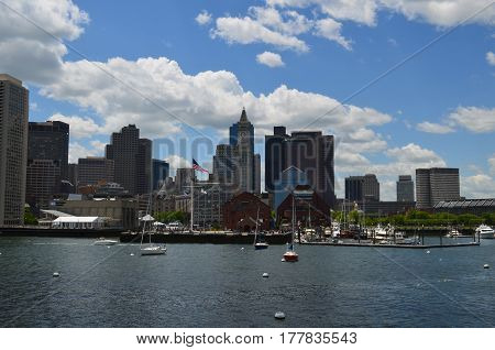 A summer day with boats morred in Boston harbor.
