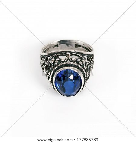 Silver ring with a blue stone isolated on a white background