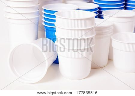 Empty white and blue food plastic glasses