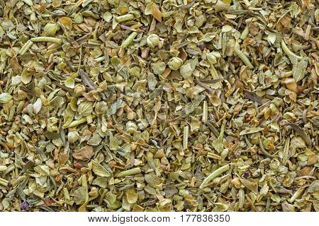 Closeup texture of dried blend Italian Seasoning mix. Spices consist of basil, oregano, rosemary, thyme, sage, cilantro as main ingredients to flavor Italian dishes