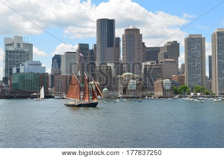 Beautiful large red sailboat in Boston Harbor on a summer day.