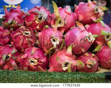 Photo of fresh dragon fruit at street store