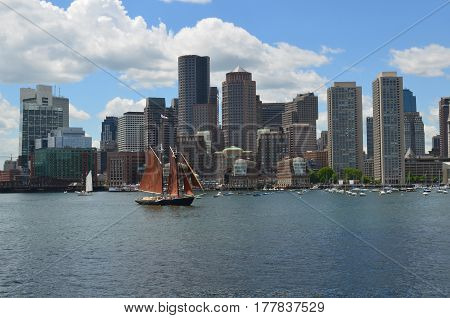 A sailboat sailing in Boston harbor on a perfect summer's day.