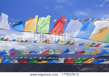 Scenery of Meili snow mountain with prayer flags at the gate of Deqing city Yunnan China