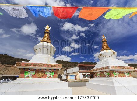 Prayer flags and stupas at the gate of Deqing city Yunnan China