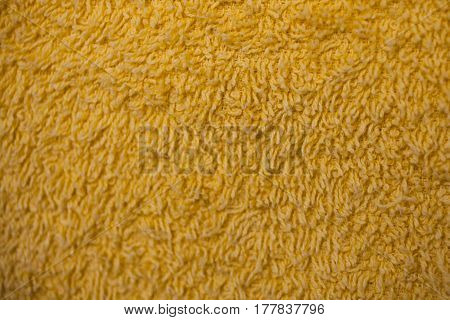 Yellow fabric texture. Yellow cloth background. Close up view of yellow fabric texture and background. Abstract texture and background for designers. Yellow texture. Macro fiber texture.