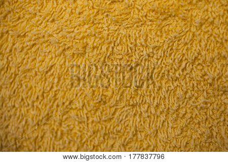 Yellow fabric texture. Yellow cloth background. Close up view of yellow fabric texture and background. Abstract texture and background for designers. Yellow texture. Macro fiber texture.