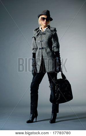 fashion model posing at light background